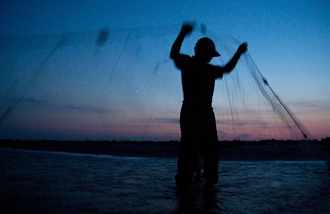 Antip Listarov sets his gill-nets at dusk in the Black Sea, near Sulina.